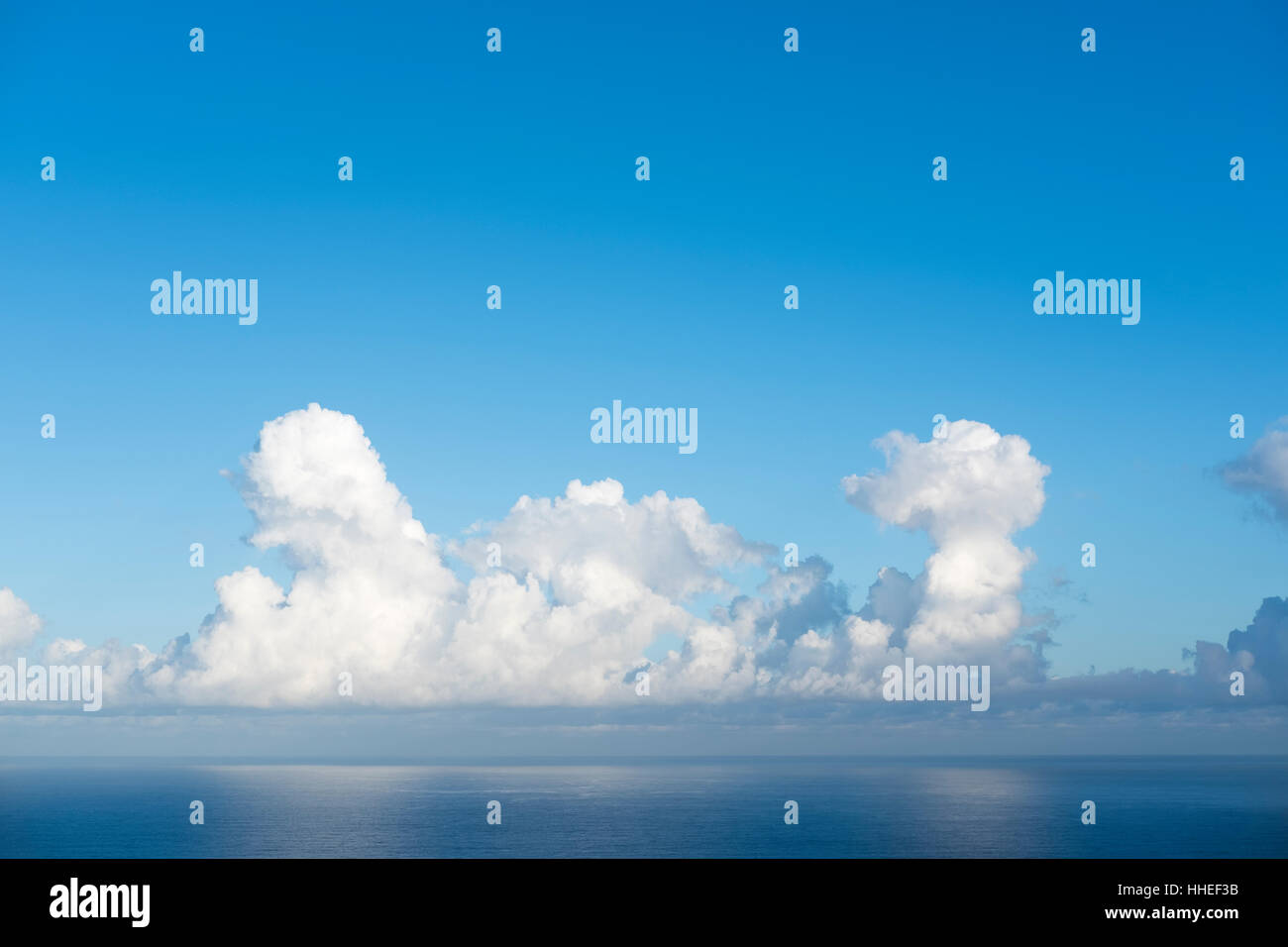 Cumulonimbus clouds above sea, Tenerife, Spain - Stock Image