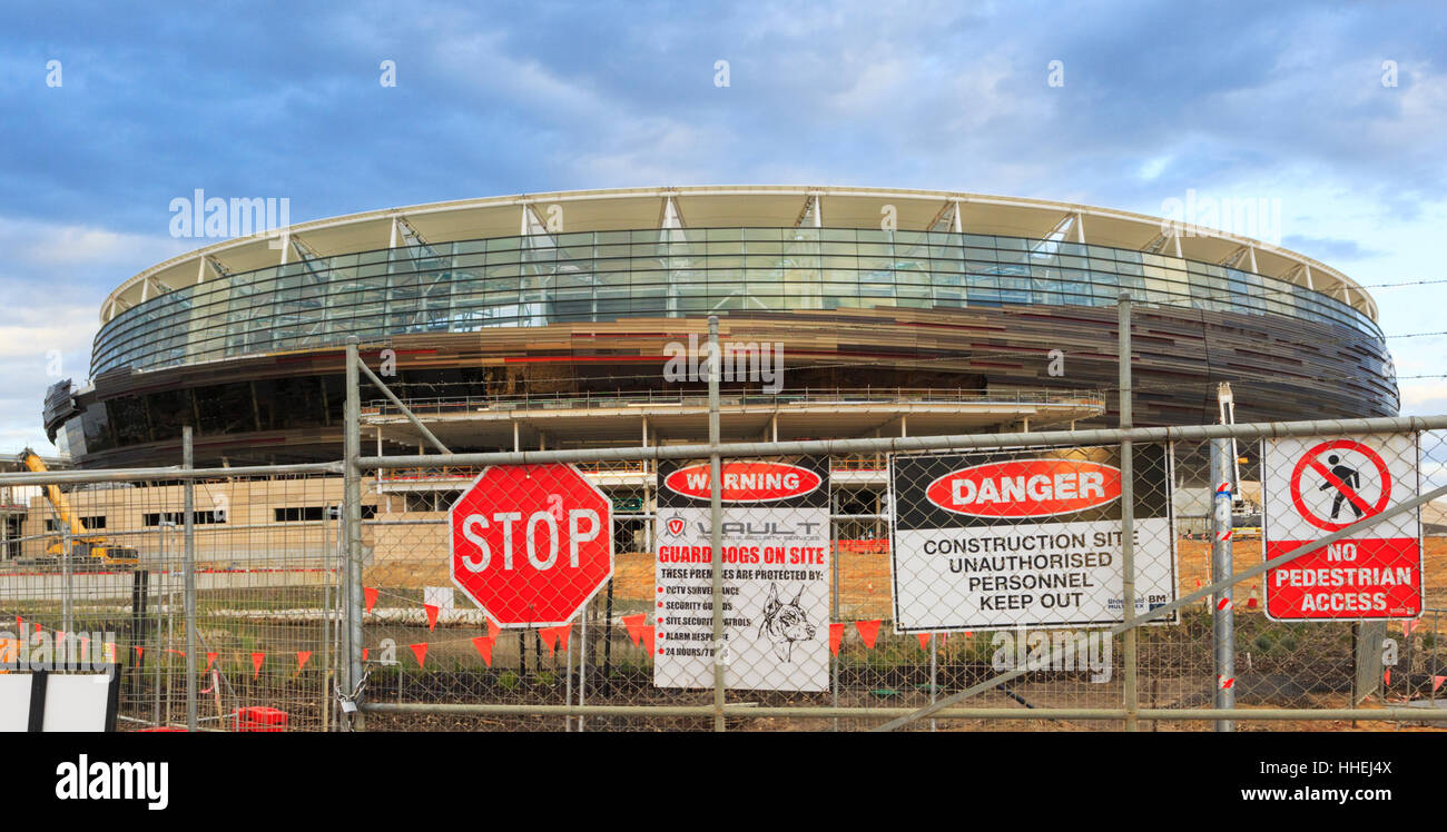 Construction site signs on a security fence outside the new Stadium - Stock Image