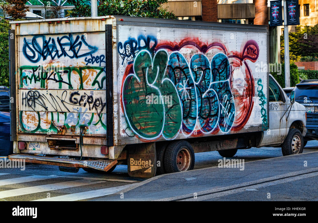 Delivery van heavily painted in graffiti on a street in Vancouver Stock Photo - Alamy