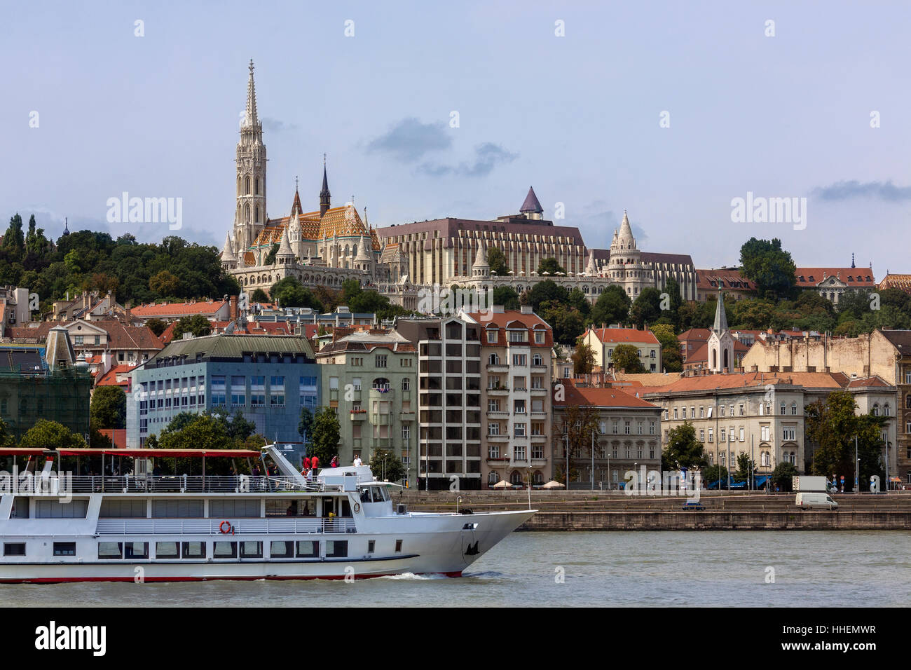 View over the River Danube to the Matyas Church or Matthias Church or the Church of Our Lady of Buda in Budapest, - Stock Image