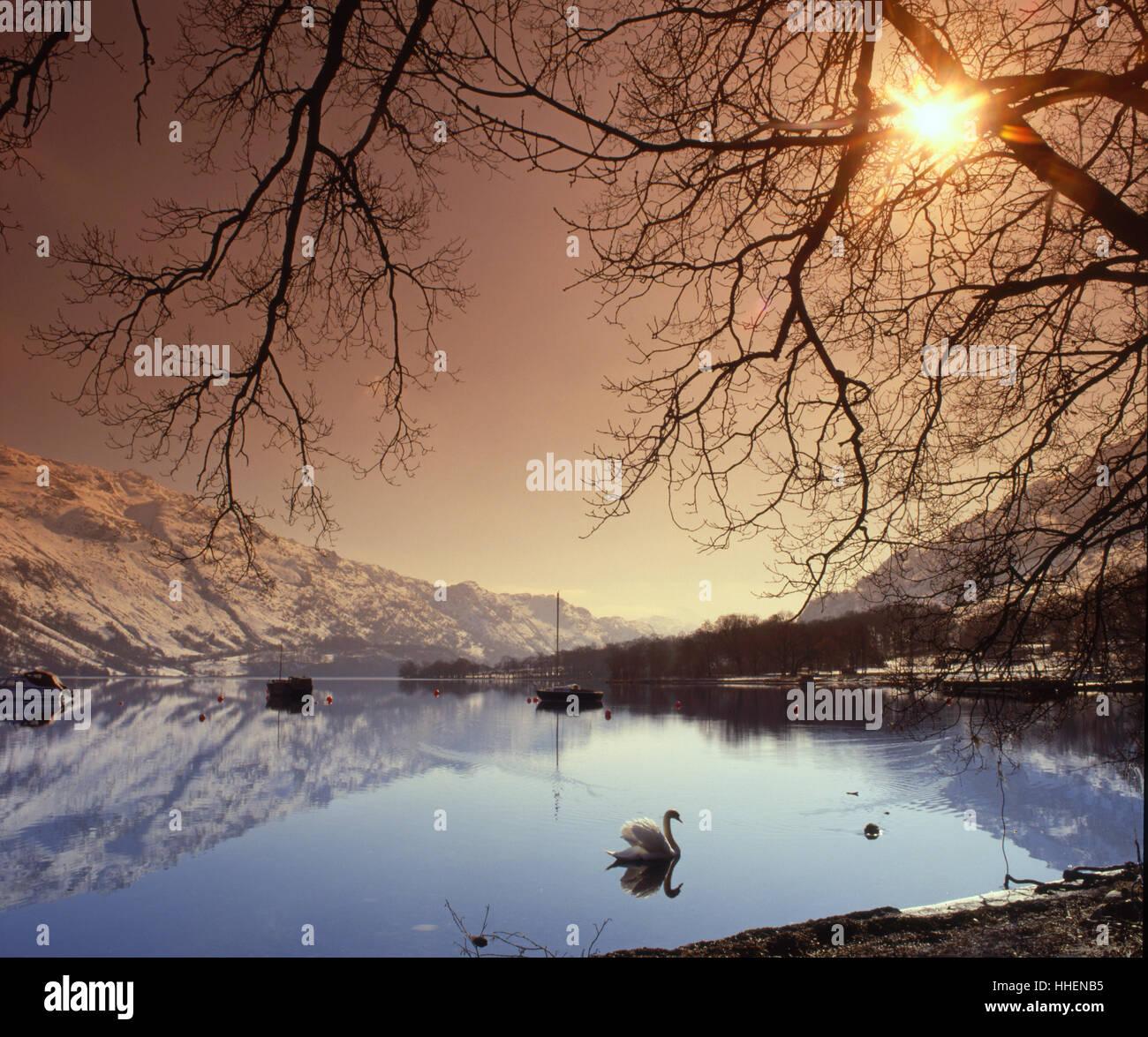 Winter starburst over Loch Lomond, Scotland - Stock Image