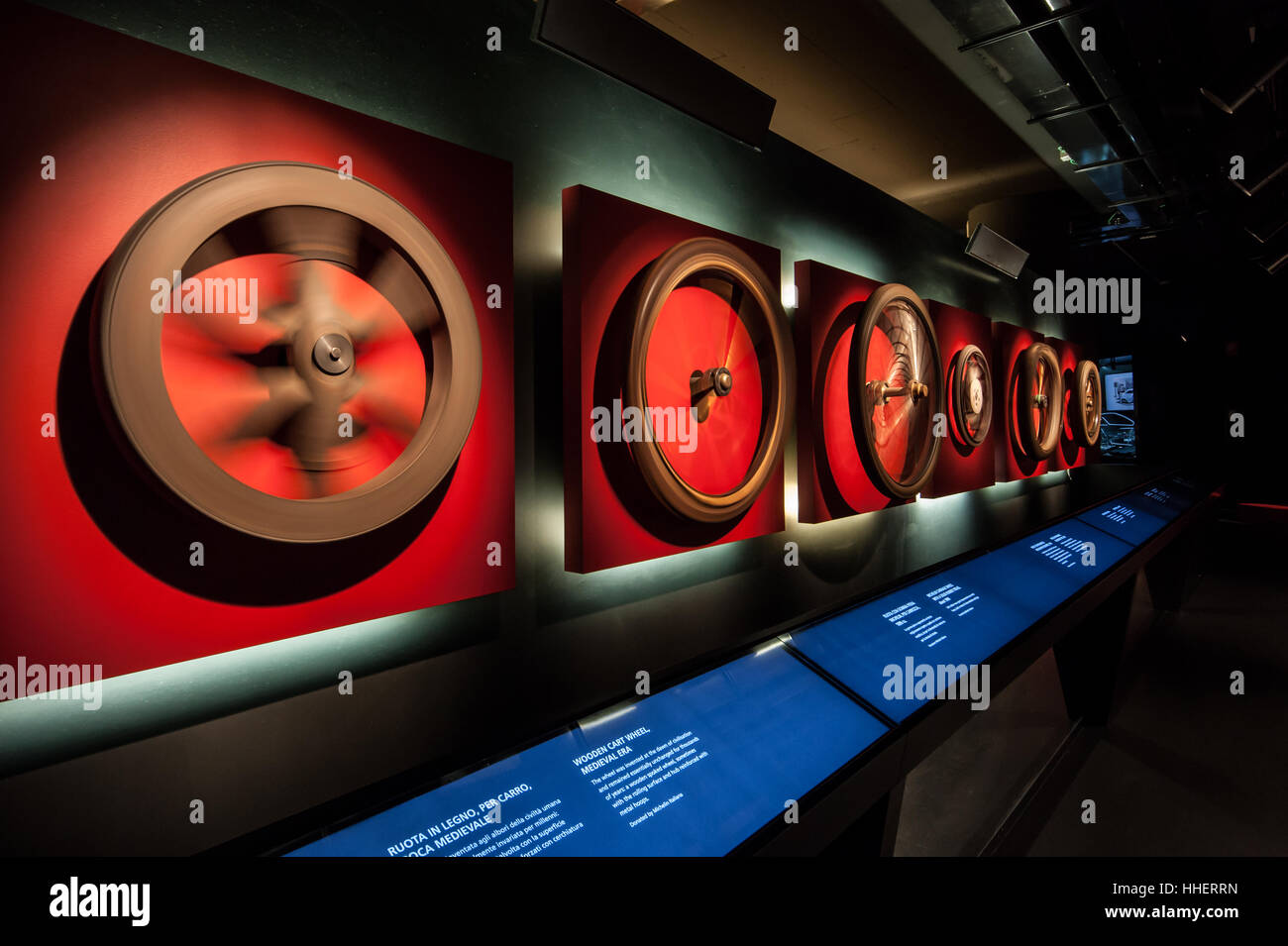Spinning wheels at the National Automobile Museum in Turin, Italy, perspective view Inexhibit magazine - Stock Image