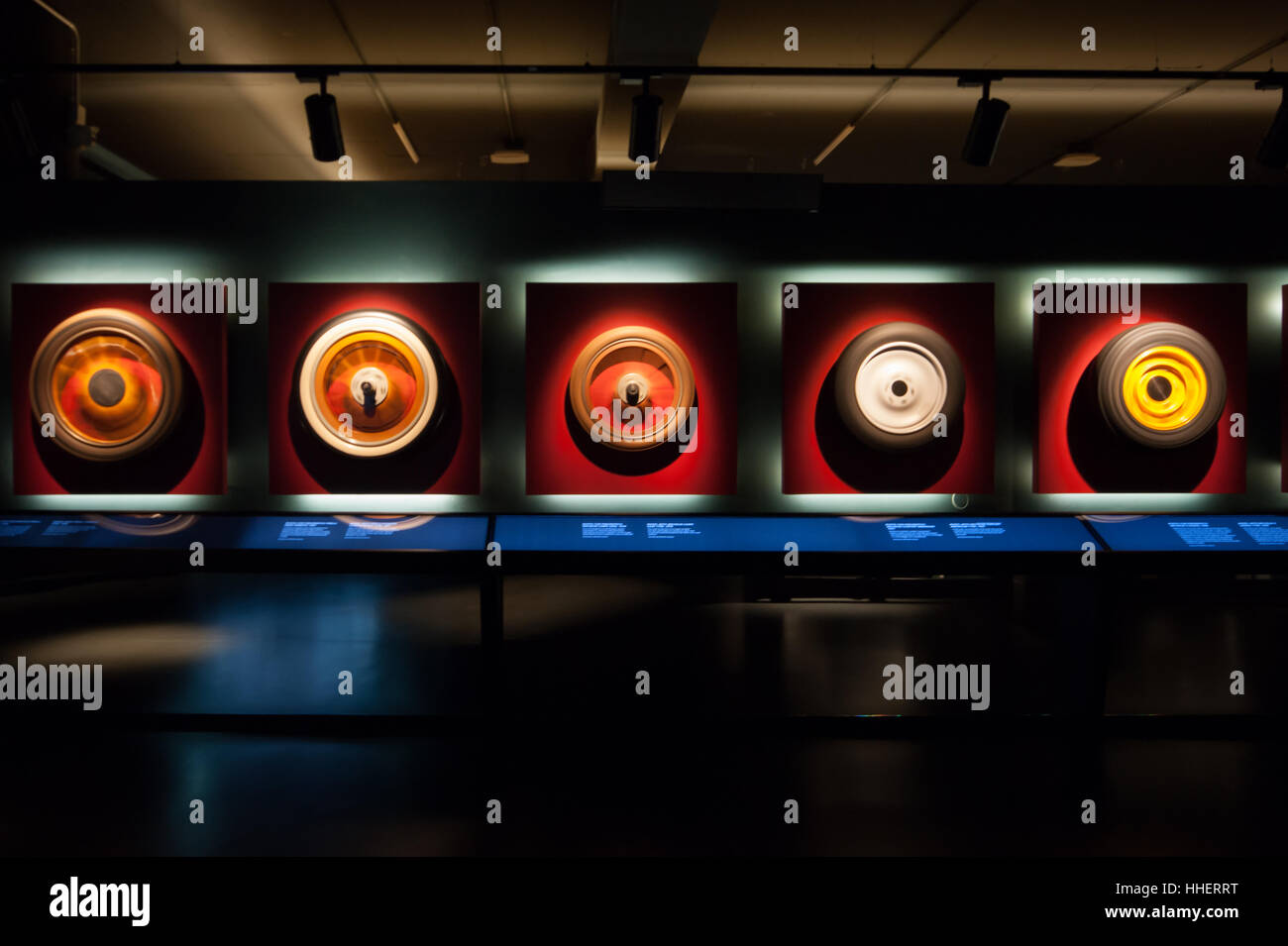 Spinning wheels at the National Automobile Museum in Turin, Italy, front view Inexhibit magazine - Stock Image