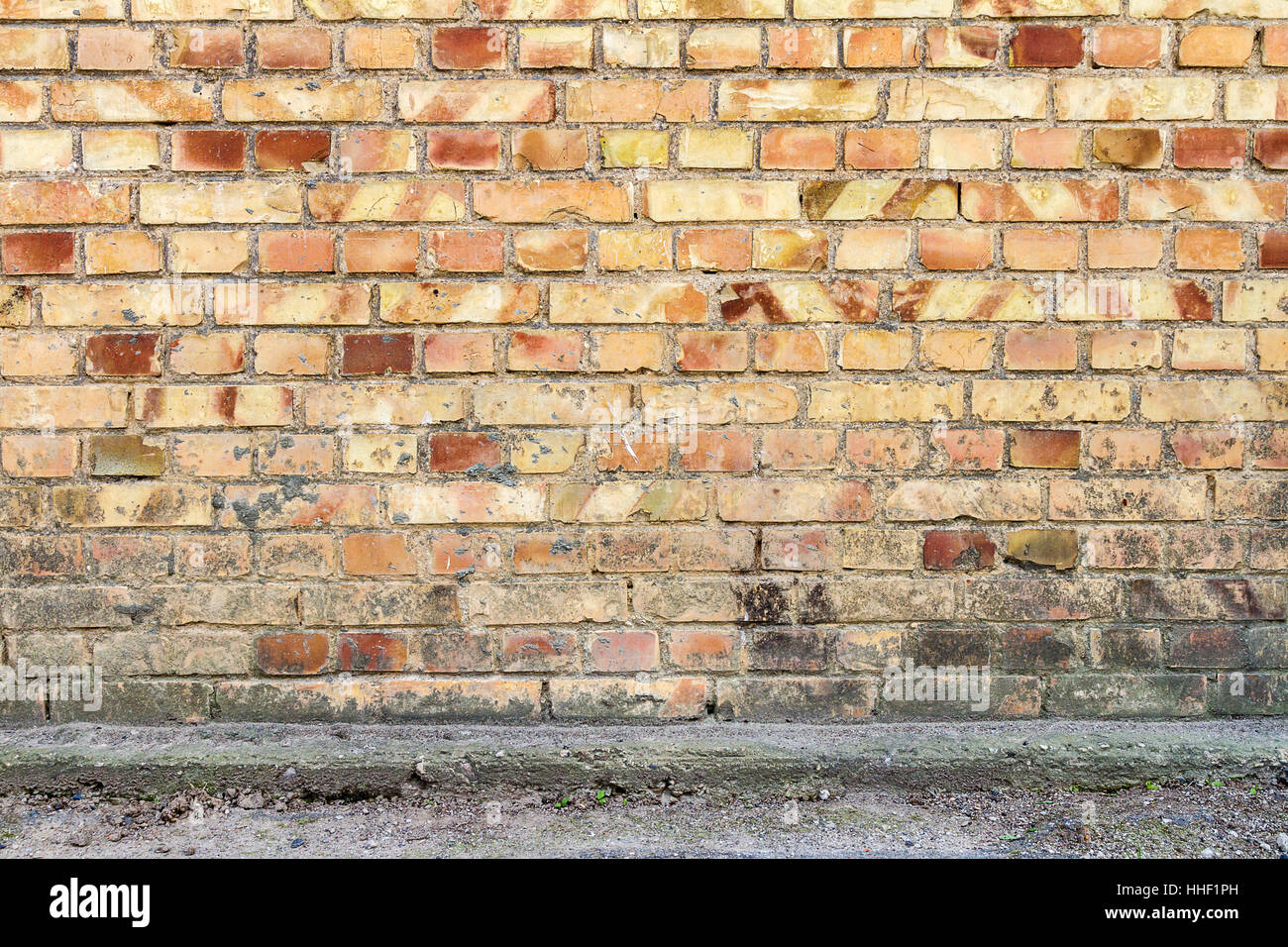 Yellow brick wall background with concrete basement & Yellow brick wall background with concrete basement Stock Photo ...