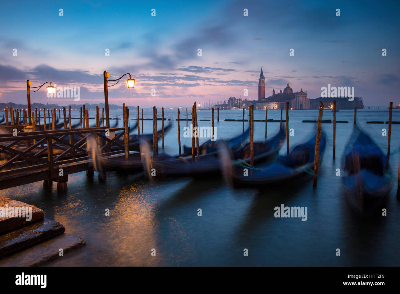 Pre-dawn light over gondolas and San Giorgio Maggiore, Venice, Veneto, Italy Stock Photo