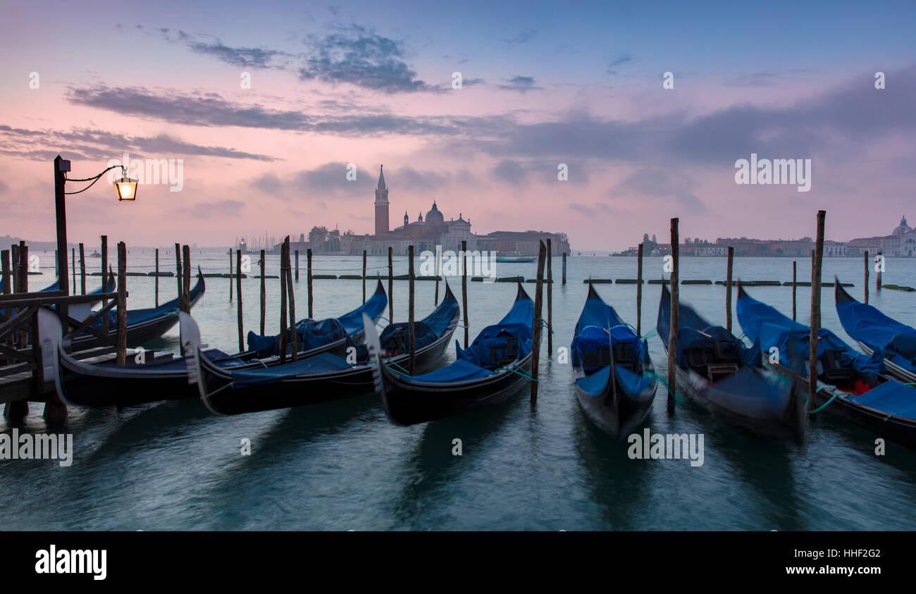 Pre-dawn light over gondolas and San Giorgio Maggiore, Venice, Veneto, Italy - Stock Image