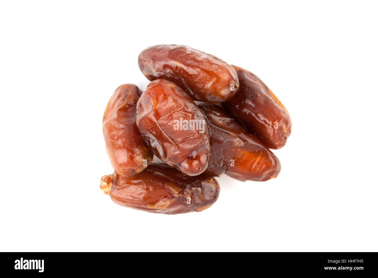 date palm dried fruit isolated on white background - Stock Image