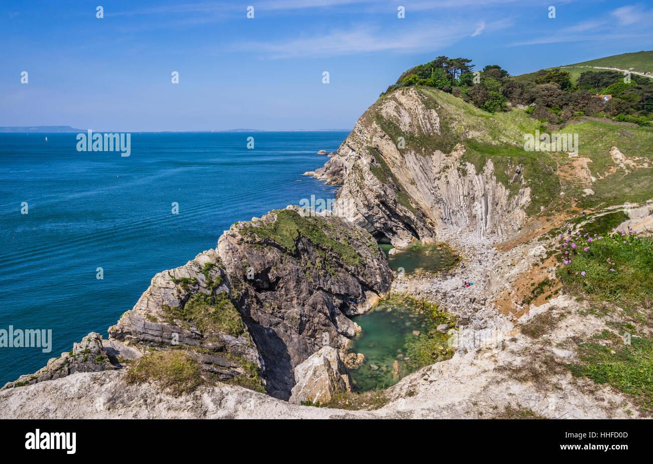Great Britain, South West England, Dorset, Jurassic Coast, Lulworth Cove, folded limestone strata at the cove of - Stock Image