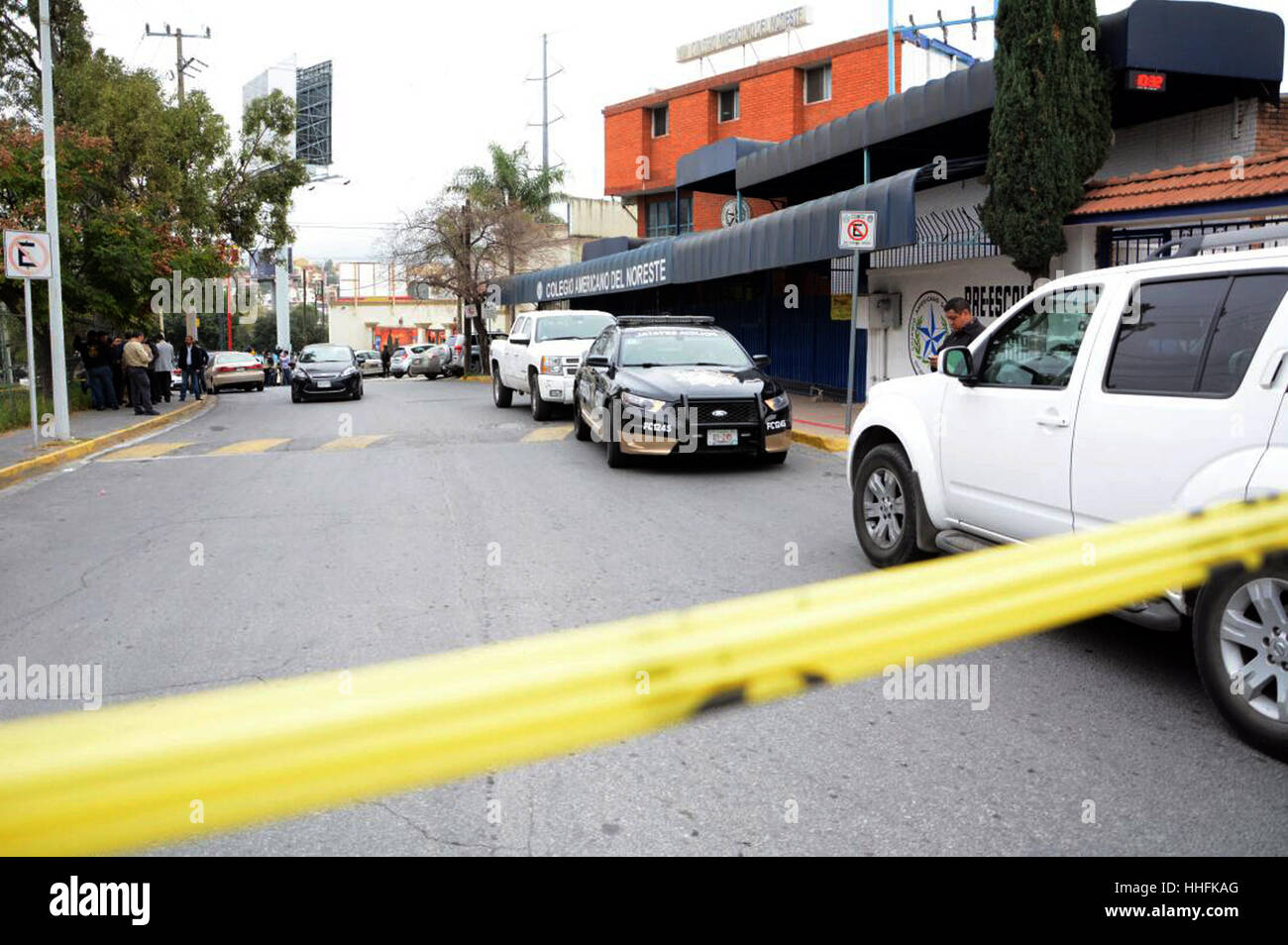 Monterrey, Mexico. 18th January 2017. People gather outside the American School of the Northeast where a shooting - Stock Image