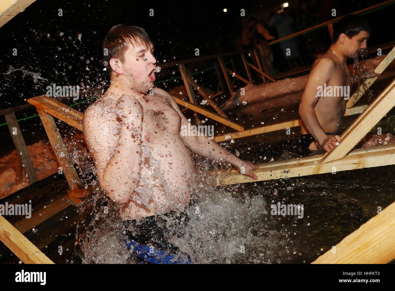 MOSCOW, RUSSIA - JANUARY 18, 2017: A man dips in the icy waters of the Borisovo Ponds during Epiphany celebrations. - Stock Image