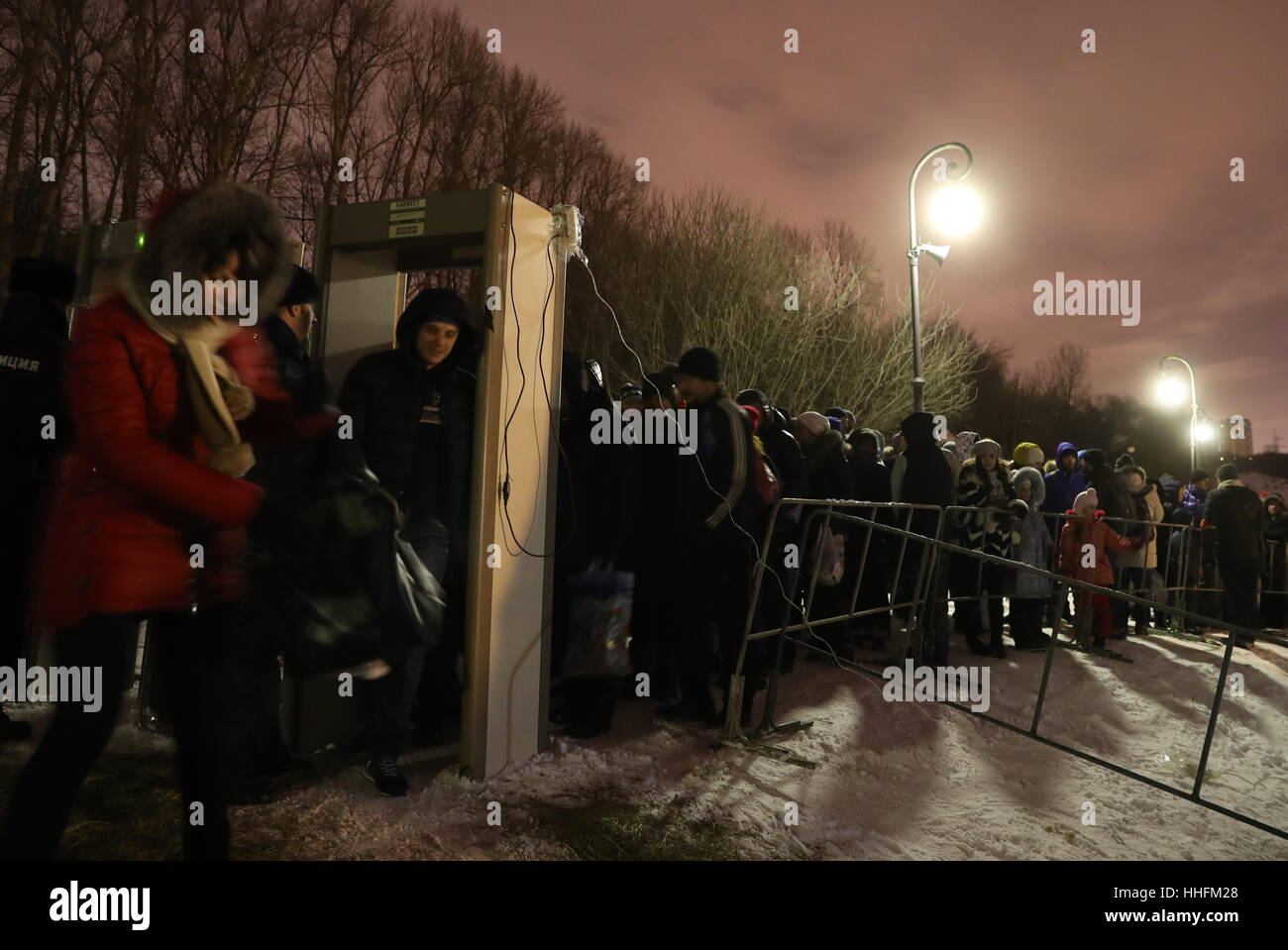 Moscow, Russia. 18th Jan, 2017. People queue to dip in the icy waters of the Borisovo Ponds during Epiphany celebrations. - Stock Image