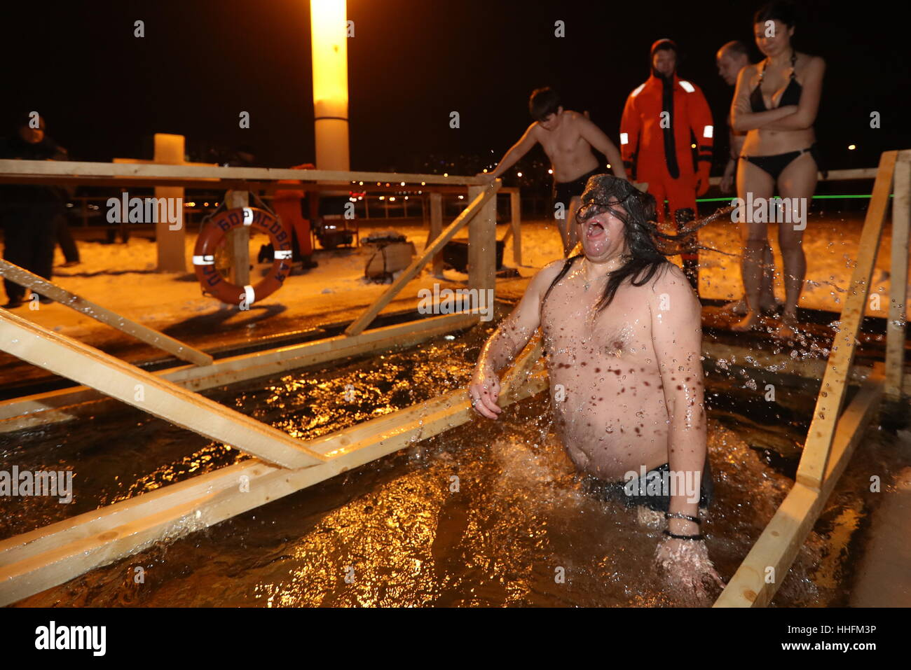 Moscow, Russia. 18th Jan, 2017. A man dips in the icy waters of the Borisovo Ponds during Epiphany celebrations. - Stock Image