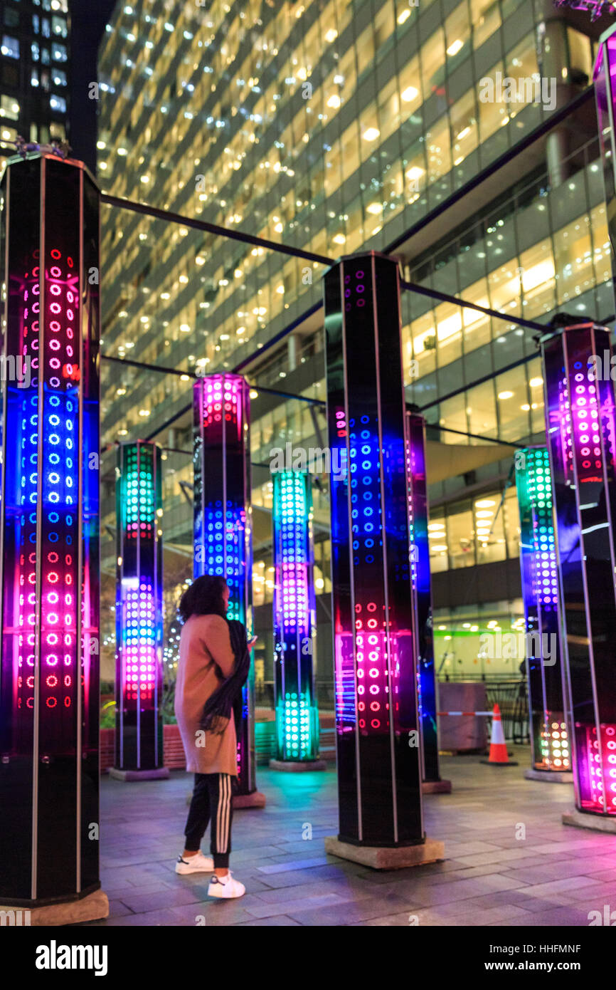 London, UK. 18th Jan, 2017. A woman interacts with the 'Cathedral of Mirrors' installation of twelve towering - Stock Image