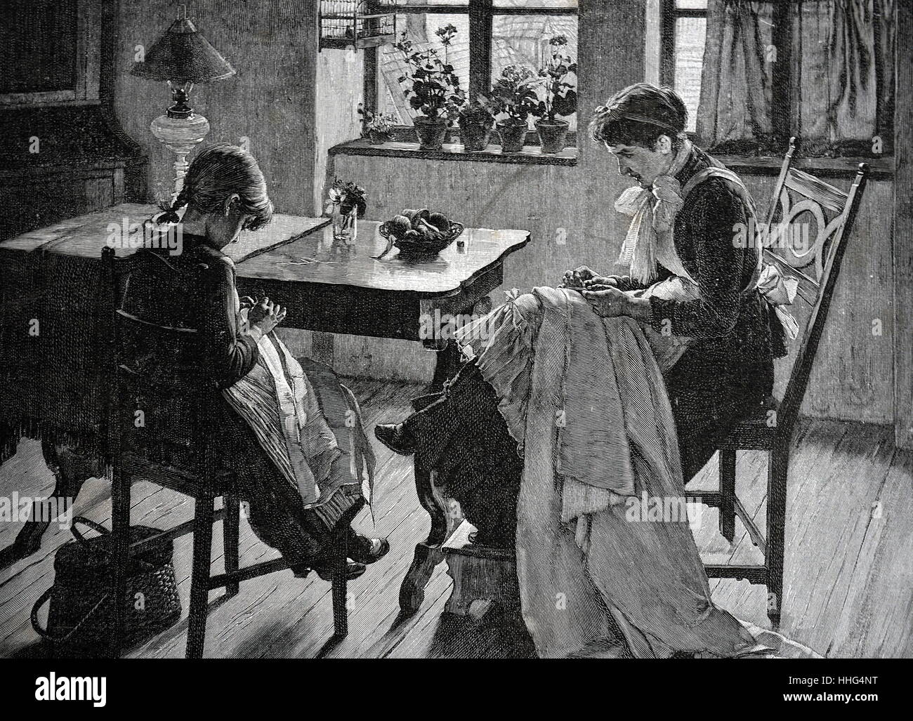 Women and daughter sitting at the dinner table, practicing their needlework. Dated 1893. - Stock Image