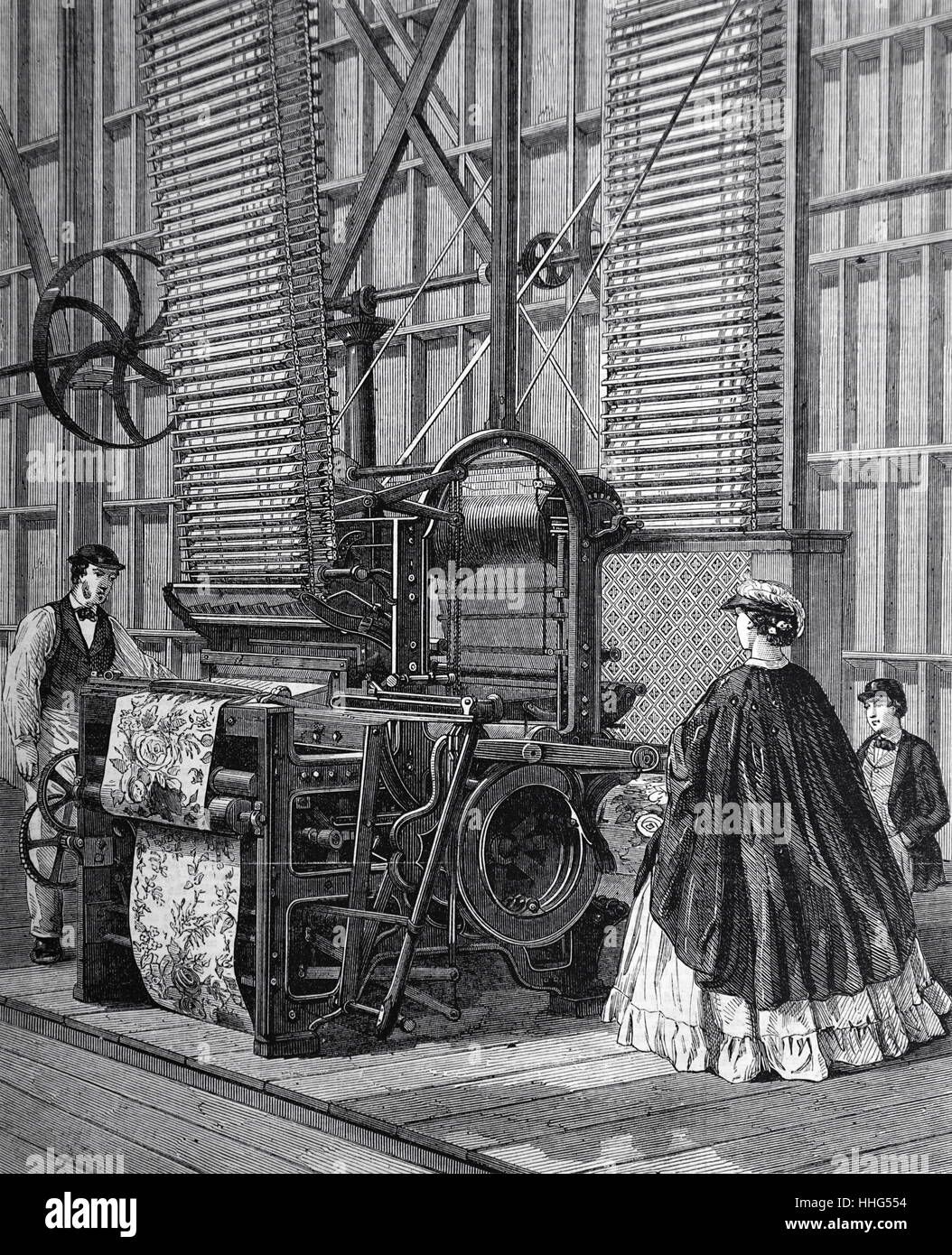 Smith's Powered loom in a factory, used for weaving tufted pile carpets. - Stock Image