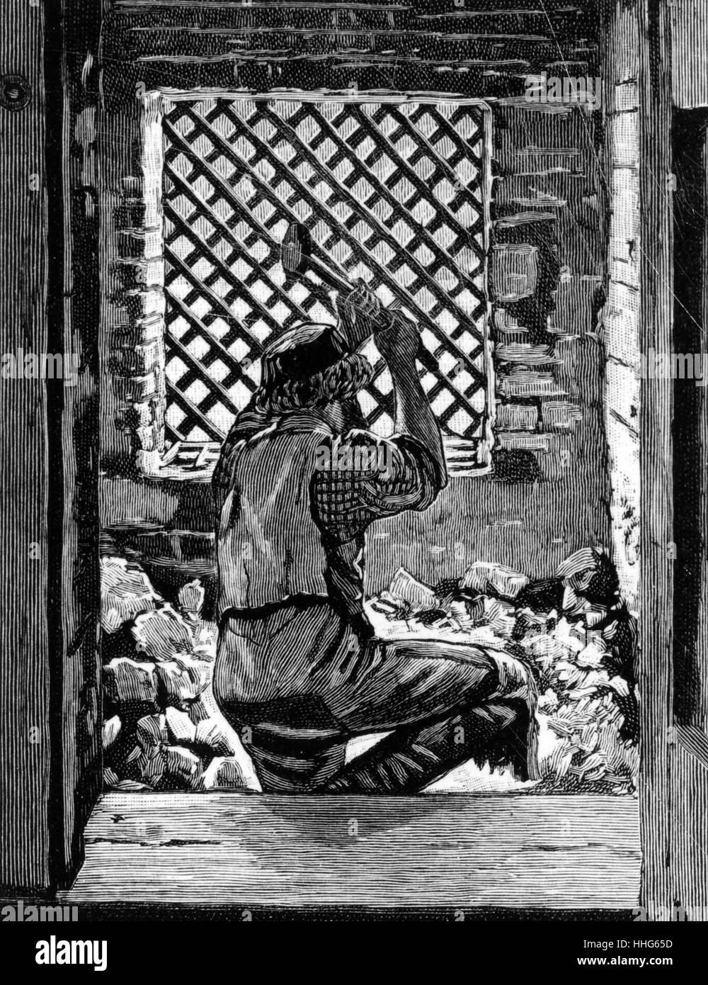 Stone breaking in the casual ward of a typical London workhouse. 1895. - Stock Image