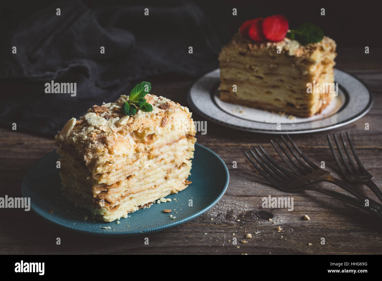 Napoleon cake - multi layered cake with pastry cream. Low key image, food still life, rustic style - Stock Image