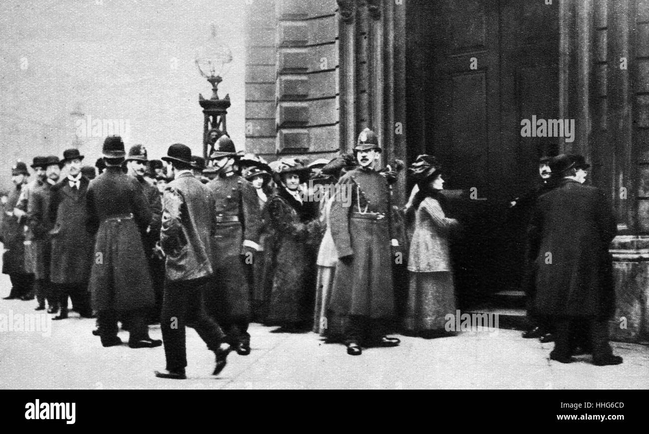 Suffragettes waiting outside Bow Street Police Station, London, to answer charges of public disorder such as brick - Stock Image