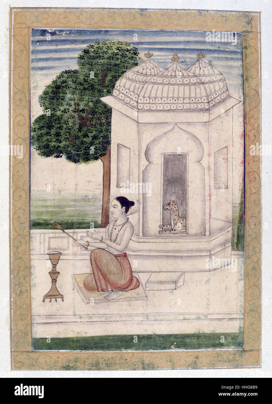 Indian Mughal miniature depicting a young ascetic in front of a pavilion guarded by a leopard. - Stock Image