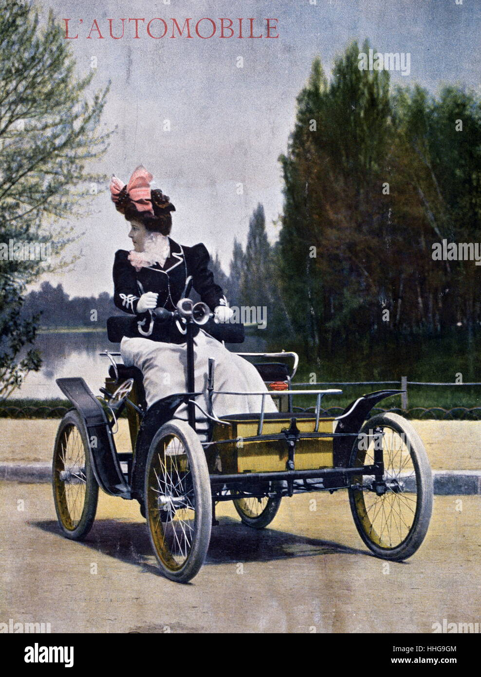 An 1899 Decauville Voiturelle motorcar driven by a woman - Stock Image