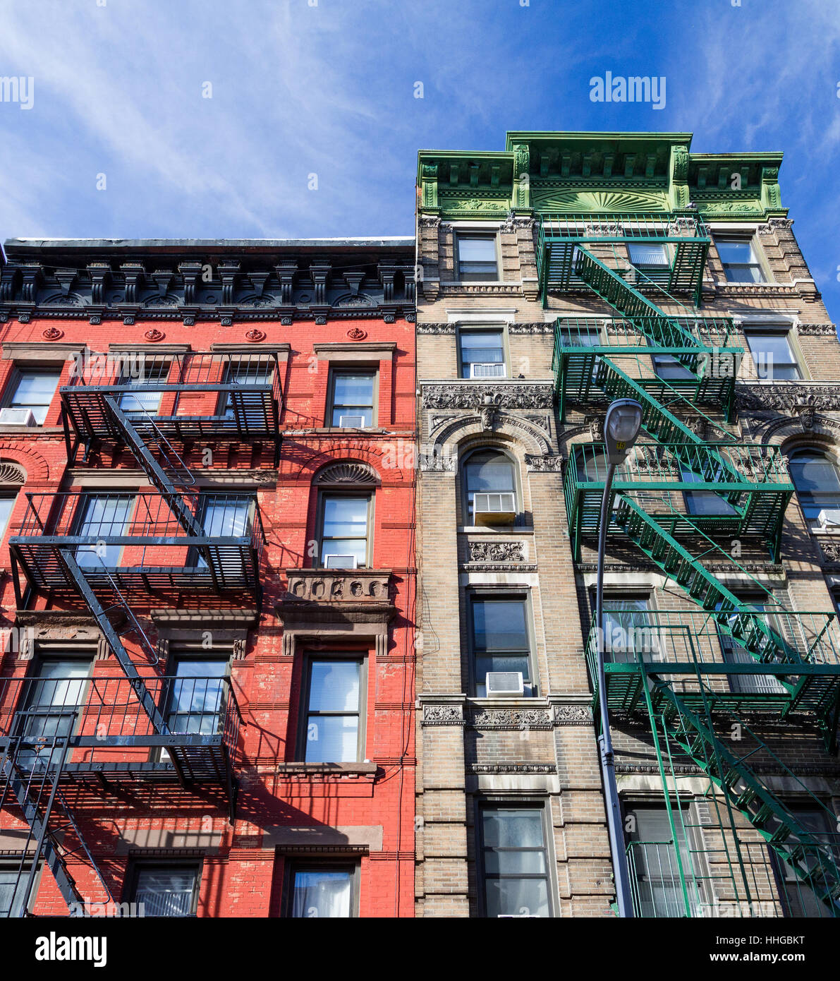 Colorful old vintage apartment buildings with fire escapes in the Greenwich Village neighborhood of Manhattan in - Stock Image
