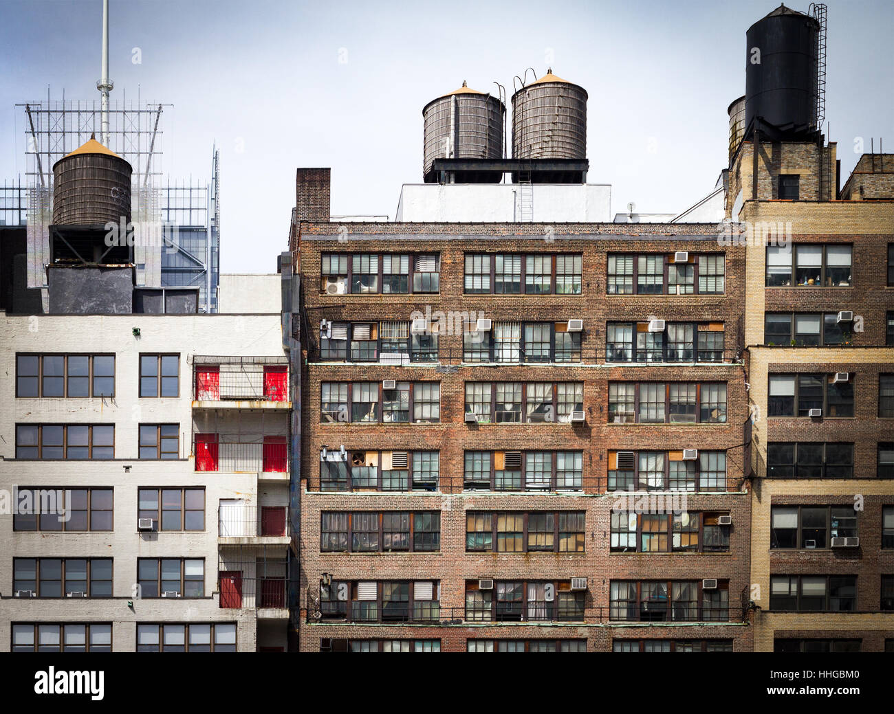 city building windows. Old Vintage Apartment Buildings With Wall Of Windows And Water Towers On  The Roof Tops In Downtown New York City