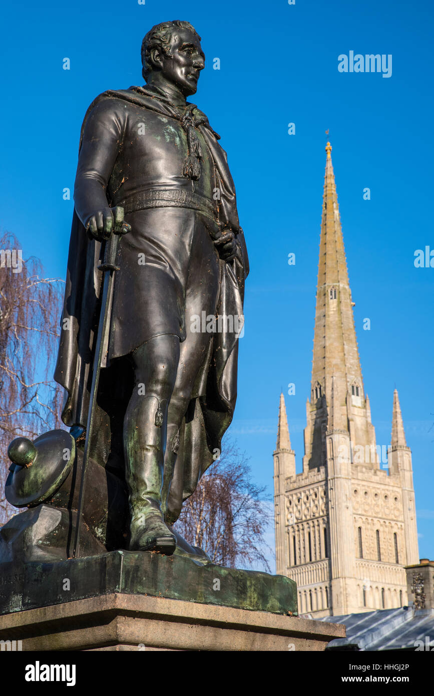 A statue of the Duke of Wellington with the beautiful Norwich Cathedral in the background, in the historic city - Stock Image