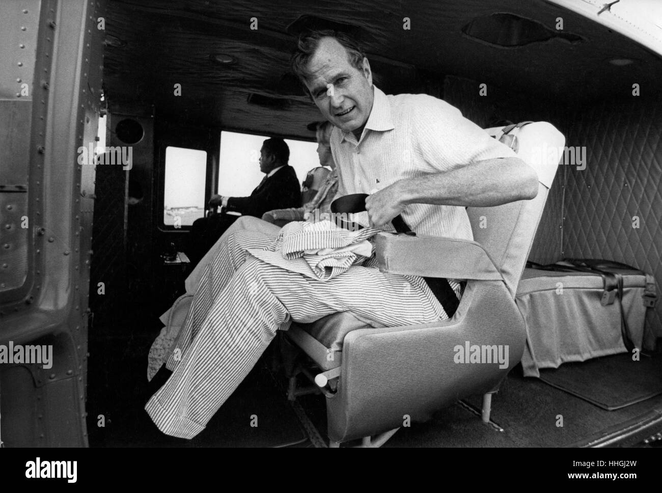 C.I.A. Director George H.W. Bush arrives in Plains, GA via a C.I.A. whitetop UH-1 helicopter to brief President - Stock Image