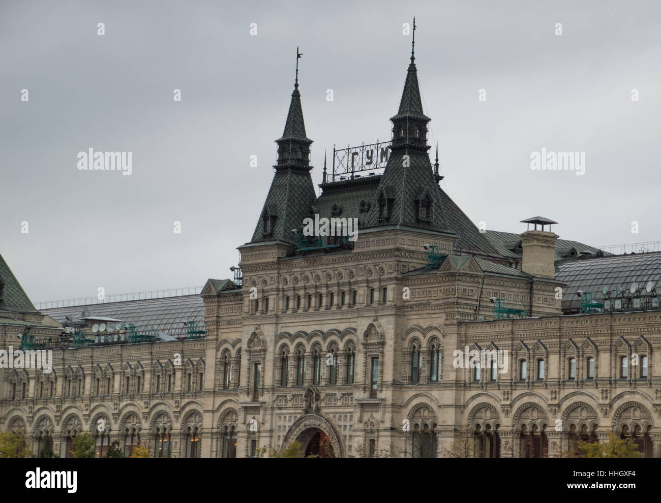 The ornate exterior of GUM, an upscale indoor shopping mall on Red Square in Moscow Russia. Photographed against - Stock Image