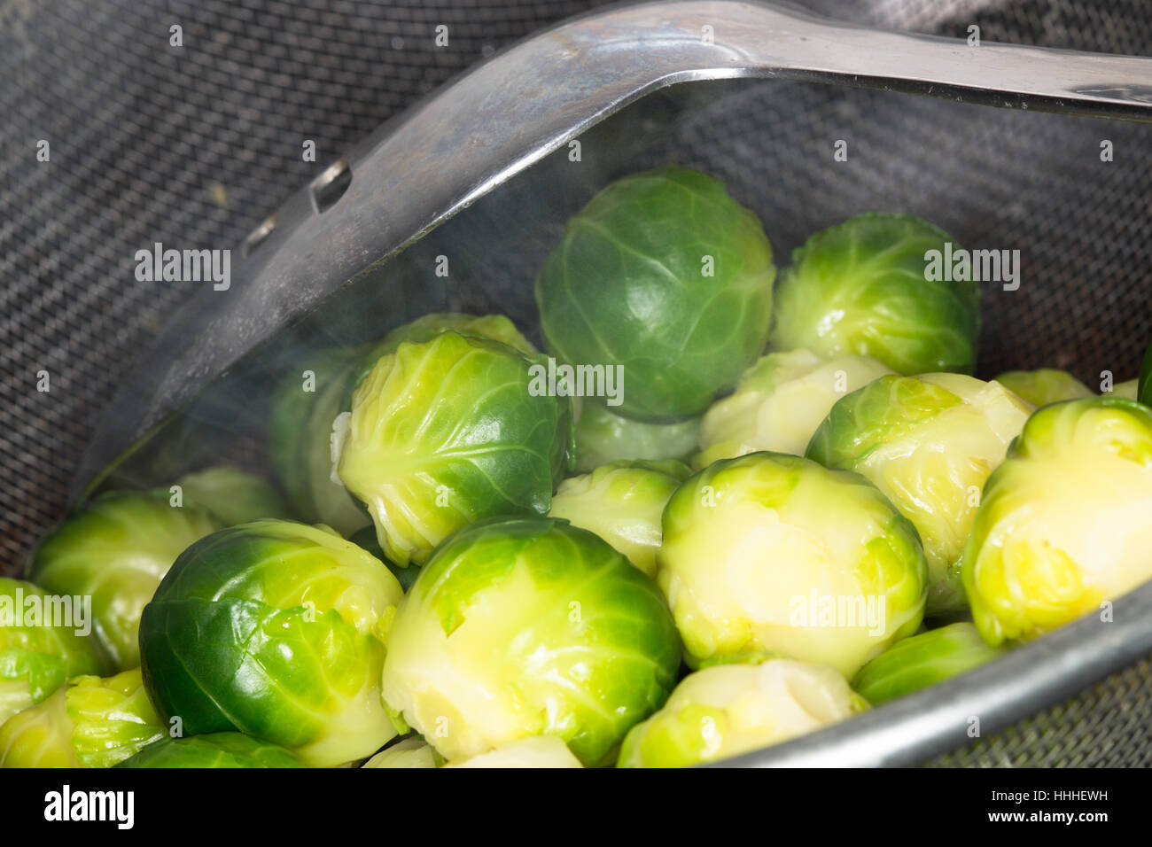 Boiled fresh cooked Brussel Sprouts. - Stock Image