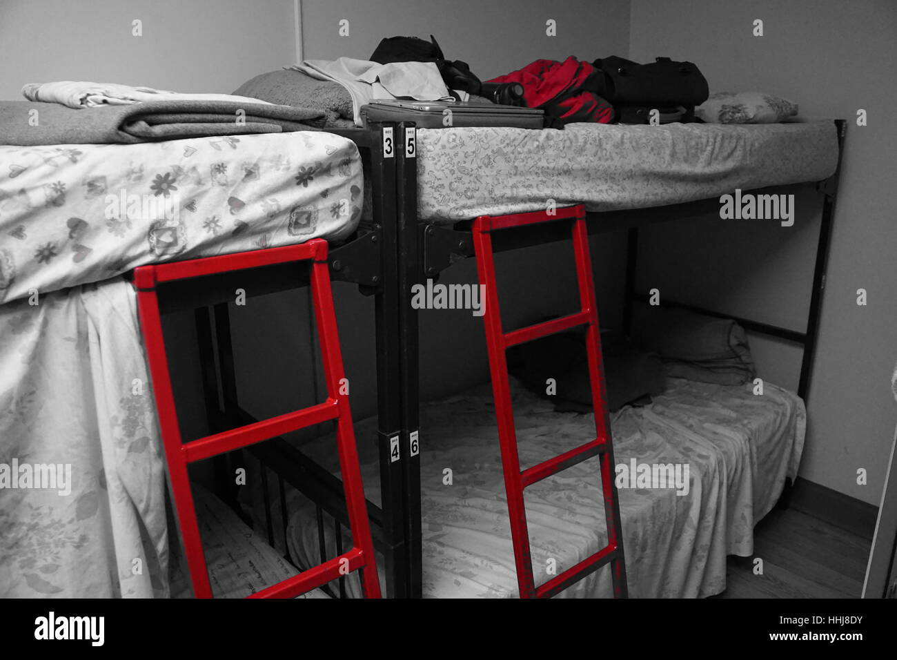 Picture of: Black And White Hostel Dorm Room With Bunk Beds Red Coloured Ladder Stock Photo Alamy