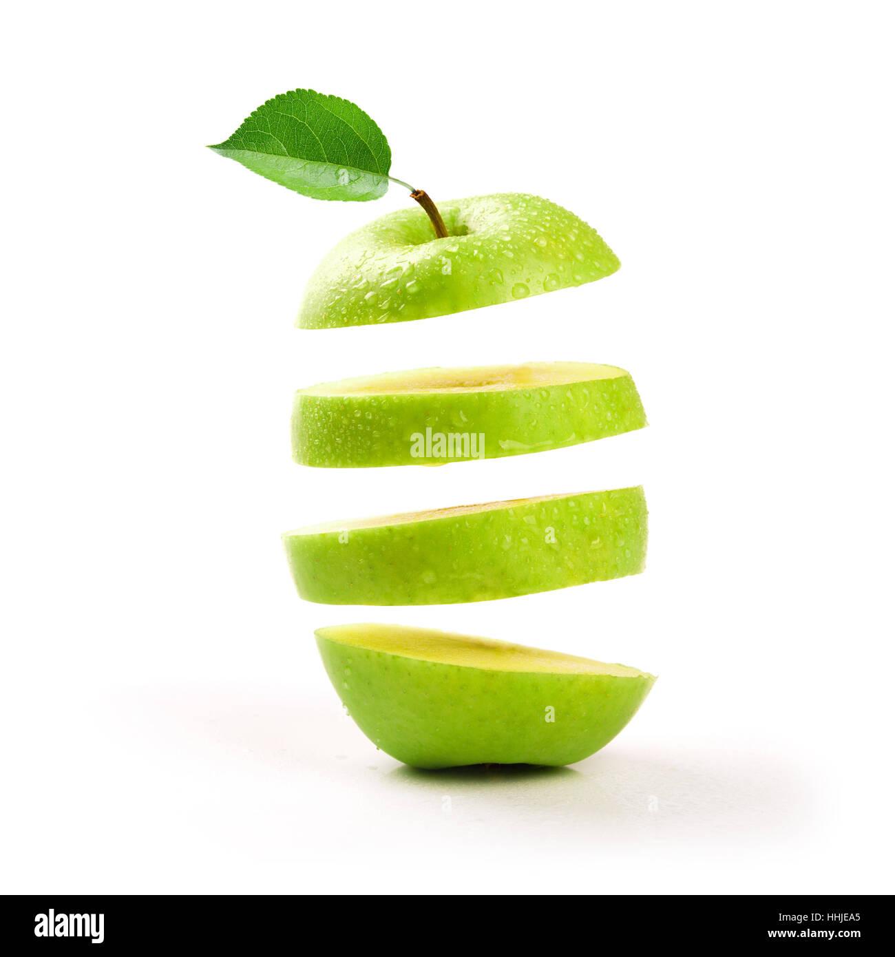 sliced green apple levitating on white background - Stock Image