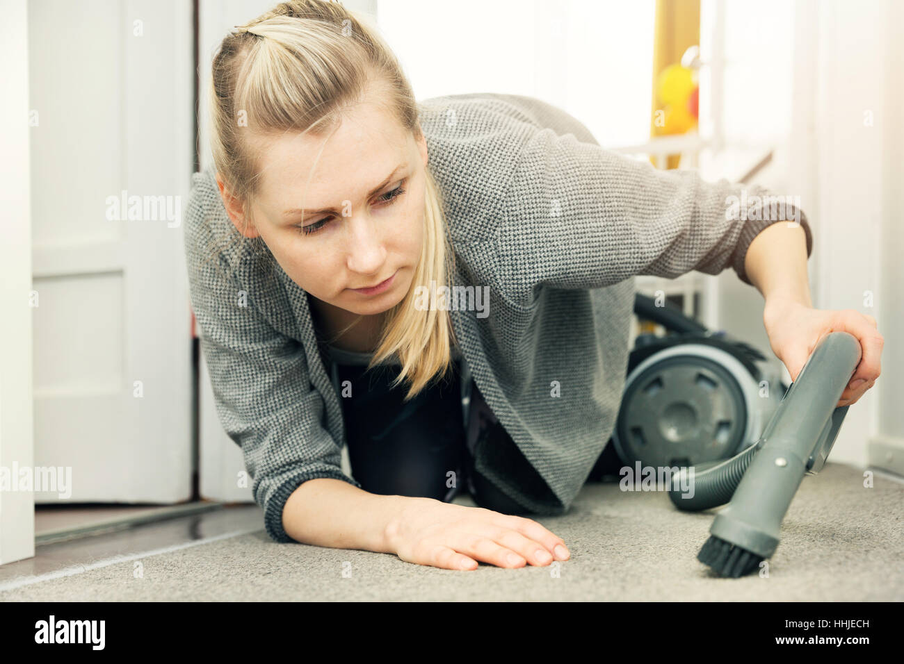 pedantic woman cleaning house with vacuum cleaner Stock Photo