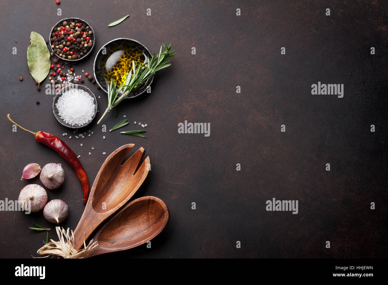Cooking table with herbs, spices and utensils. Top view with copy space - Stock Image