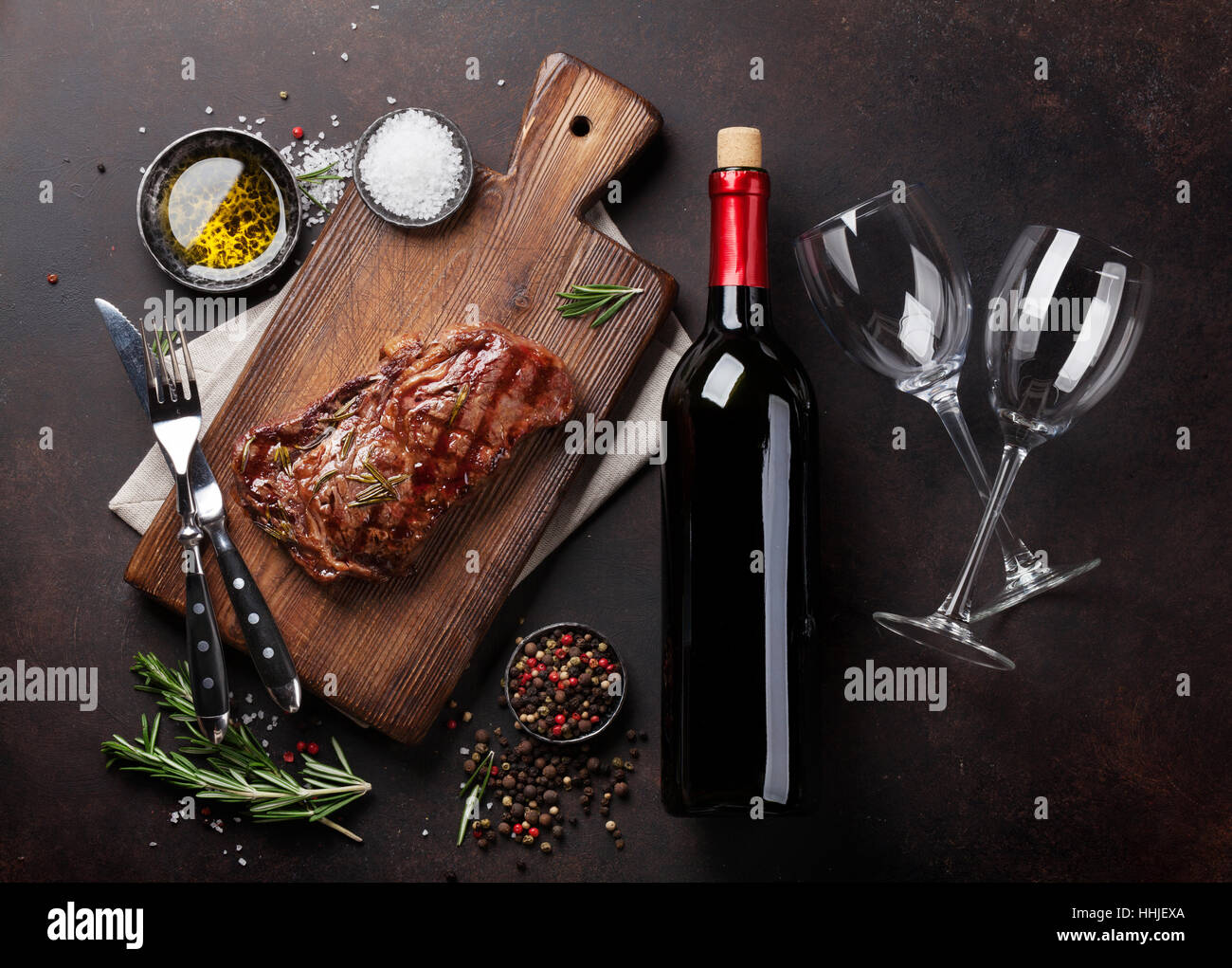 Grilled ribeye beef steak with red wine, herbs and spices. Top view - Stock Image