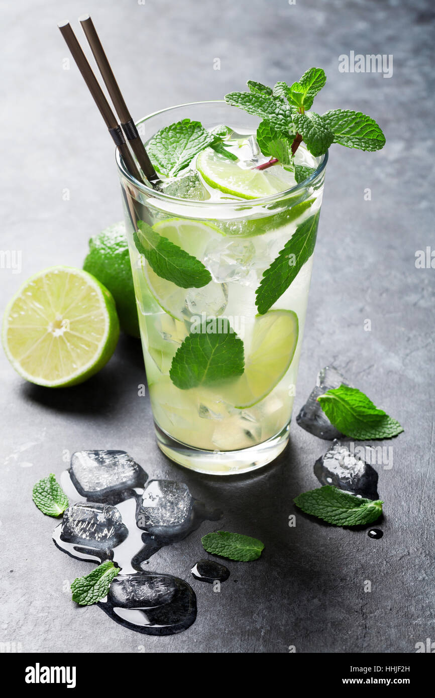 Mojito cocktail on dark stone table - Stock Image