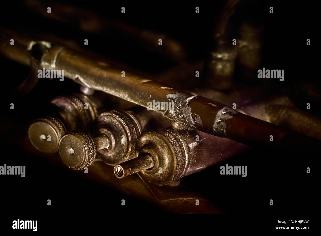 Held together with solder and it has a few holes, this was my grandpa's old trumpet.  It's played a lot - Stock Image