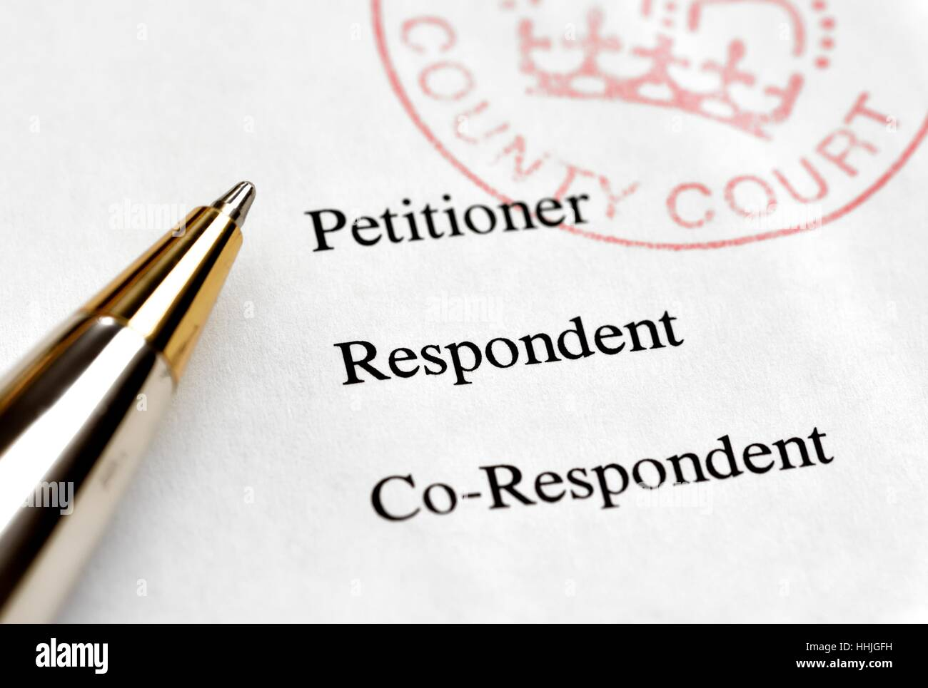 County court divorce papers, petitioner,respondent,co-respondent and a pen ready for signing. - Stock Image
