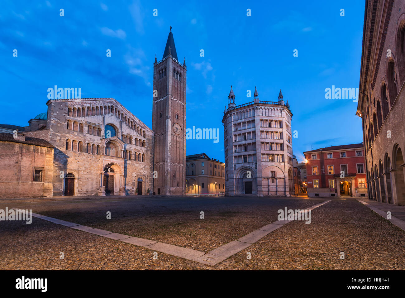 The Cathedral and the Baptistery of Parma at night - Stock Image