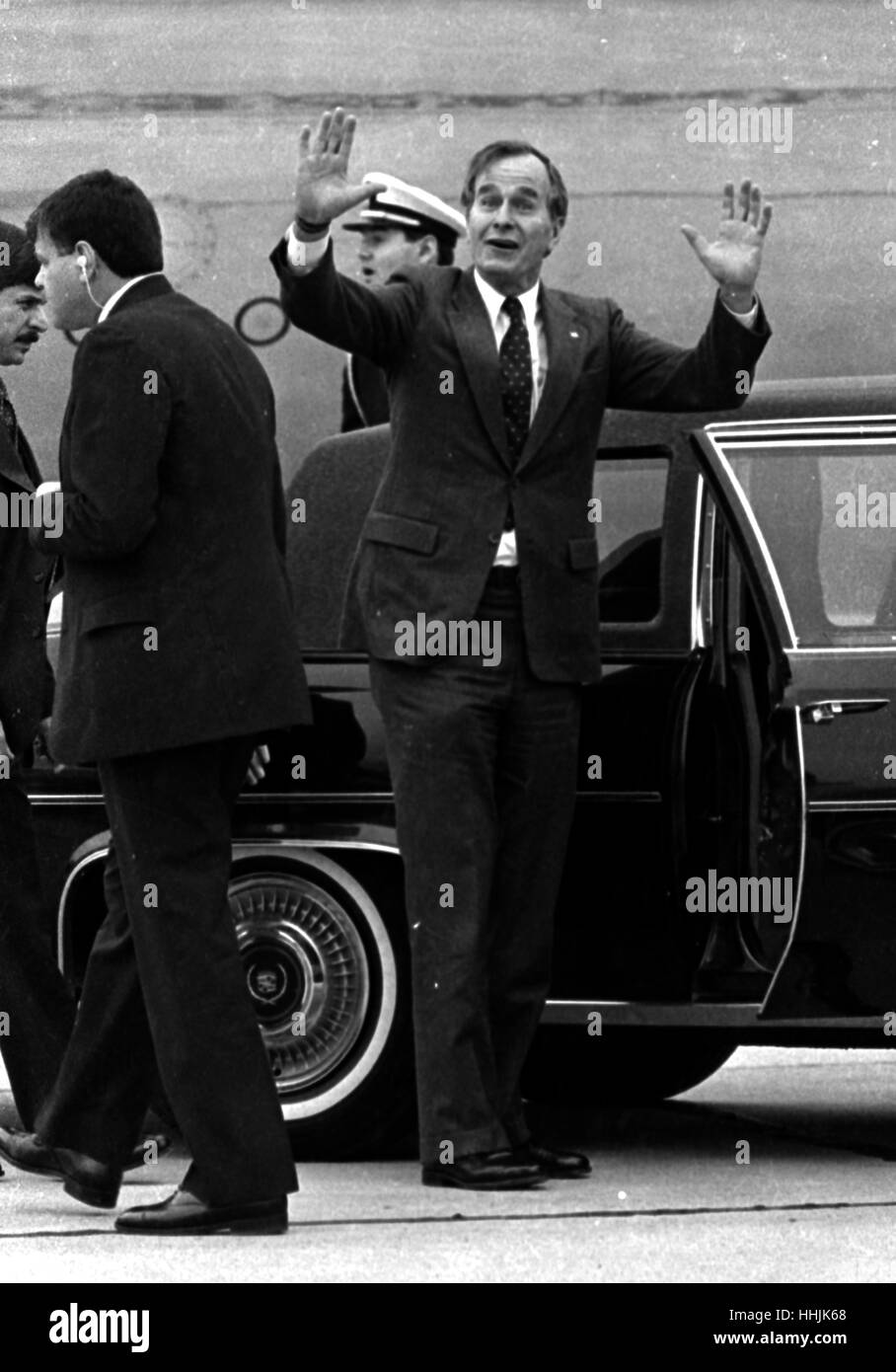 US Vice President George H Bush waves to the press being held back at Dallas' Love Field in 1984 photo by bill - Stock Image
