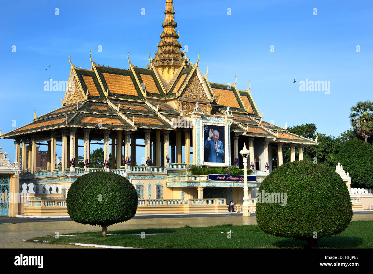 People in front of the Royal Palace ( Portrait of King Norodom Sihanouk ) 1866 Phnom Penh Cambodia Stock Photo