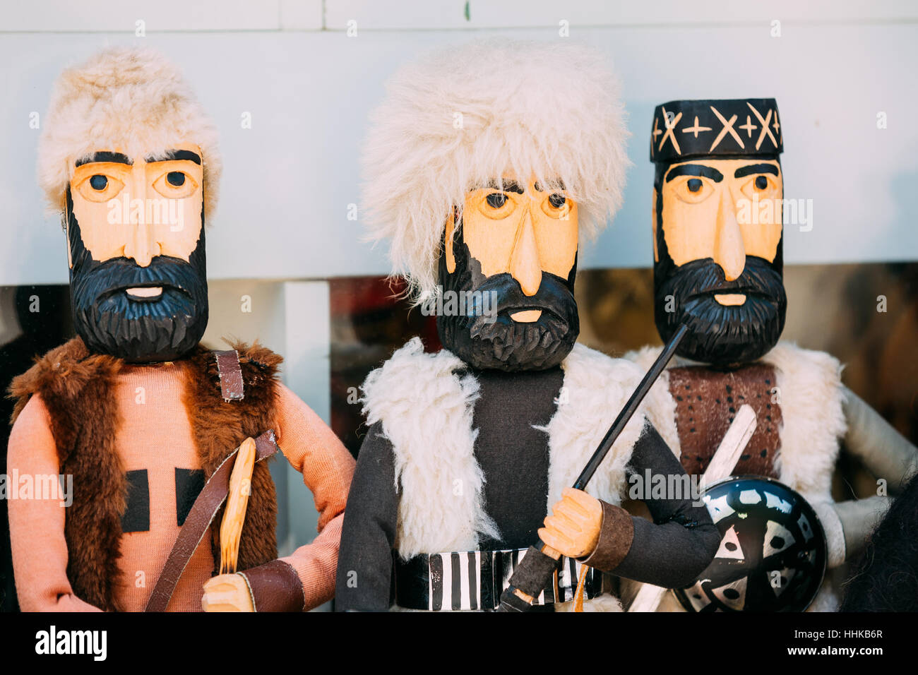 Close Three Wooden Dolls In The Similitude Of Highlanders, Caucasus Georgian Men In Traditional Clothes. - Stock Image