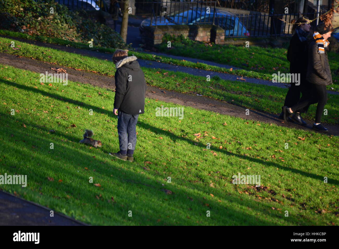 child playing with squirrel in the Brandon Hill park in Bristol,England Stock Photo