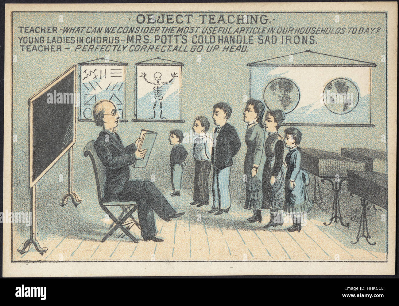 Object Teaching. Teacher - what can we consider the most useful article in our households today_ Young ladies in - Stock Image