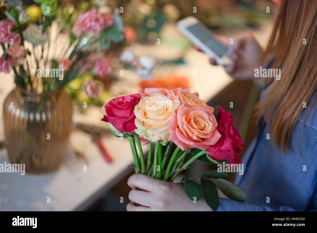 Workshop florist making bouquets and flower arrangements woman workshop florist making bouquets and flower arrangements woman collecting a bouquet of roses soft focus izmirmasajfo