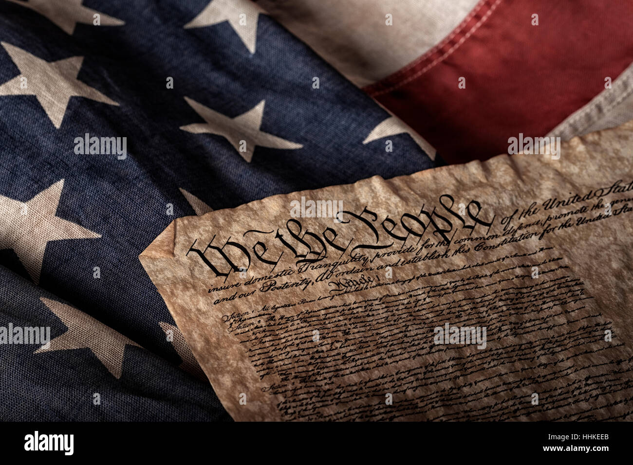 U.S. constitution on an old and worn flag - Stock Image