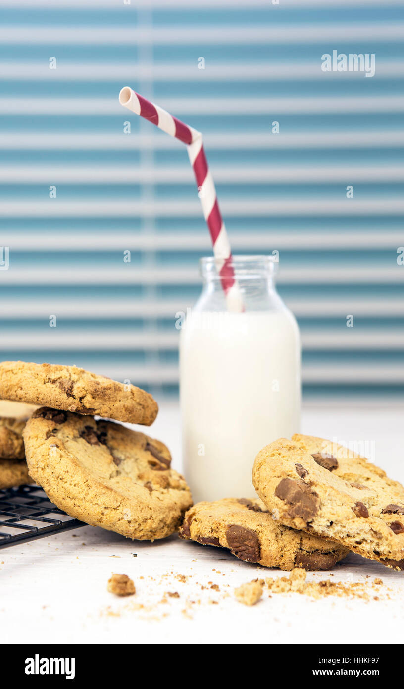 Fresh Homemade Cookies and Milk with Straw - Stock Image