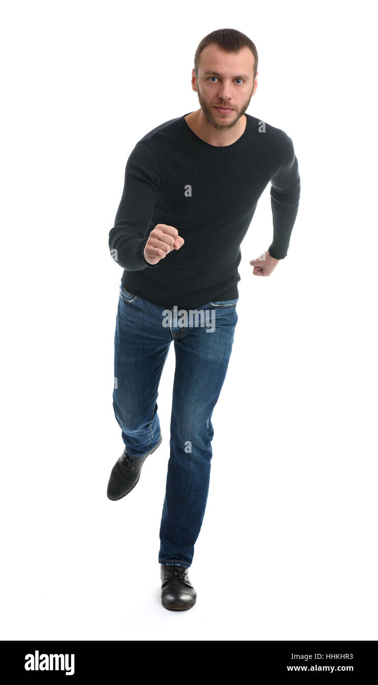 Full length portrait of a casual man running away. isolated on white background - Stock Image