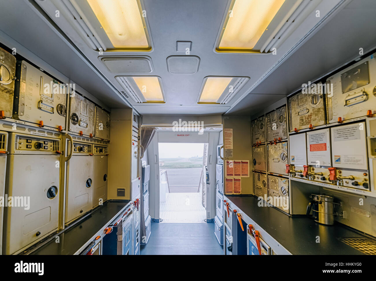 Airplane on the airfield. Inside the cabin . View from the kitchen to the main entrance to the salon. - Stock Image