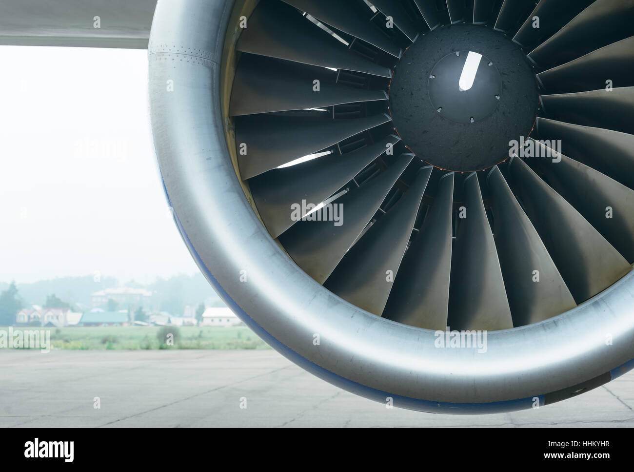 Airplane on the airfield. Screw close-up of a turbofan engine. - Stock Image